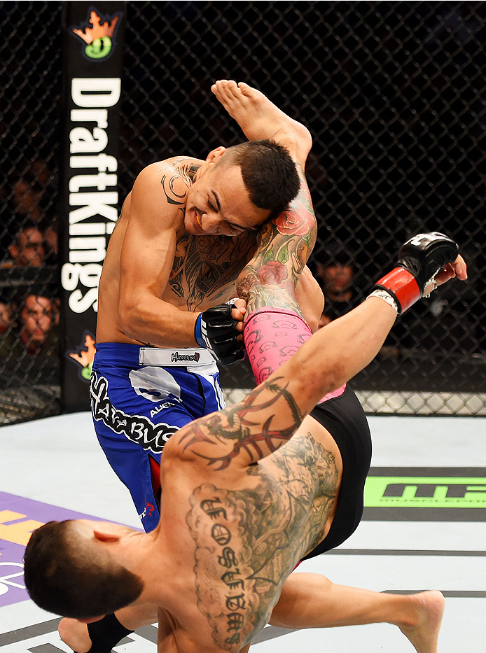 NEWARK, NJ - APRIL 18:  Cub Swanson kicks Max Holloway in their featherweight bout during the UFC Fight Night event at Prudential Center on April 18, 2015 in Newark, New Jersey.  (Photo by Josh Hedges/Zuffa LLC/Zuffa LLC via Getty Images)