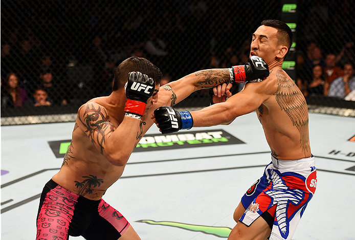 NEWARK, NJ - APRIL 18:  Cub Swanson (L) punches Max Holloway  in their featherweight bout during the UFC Fight Night event at Prudential Center on April 18, 2015 in Newark, New Jersey.  (Photo by Josh Hedges/Zuffa LLC/Zuffa LLC via Getty Images)