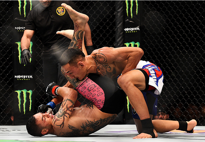 NEWARK, NJ - APRIL 18:  Cub Swanson and Max Holloway grapple in their featherweight bout during the UFC Fight Night event at Prudential Center on April 18, 2015 in Newark, New Jersey.  (Photo by Jeff Bottari/Zuffa LLC/Zuffa LLC via Getty Images)