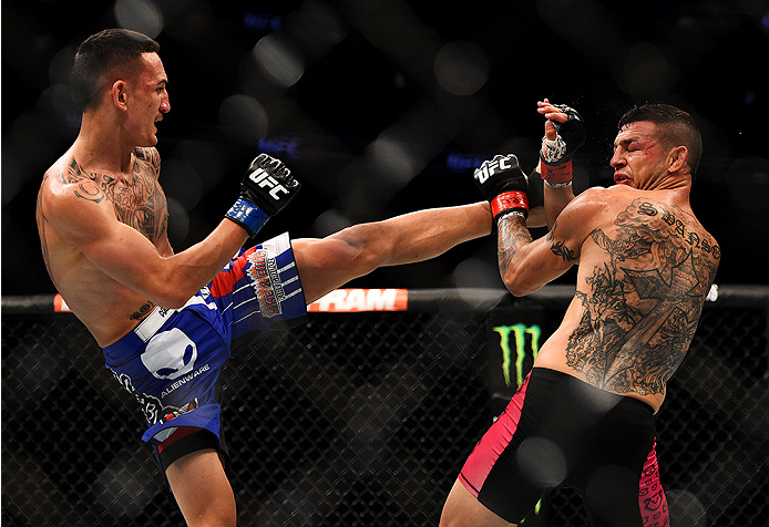 NEWARK, NJ - APRIL 18:  Max Holloway kicks Cub Swanson in their featherweight bout during the UFC Fight Night event at Prudential Center on April 18, 2015 in Newark, New Jersey.  (Photo by Jeff Bottari/Zuffa LLC/Zuffa LLC via Getty Images)