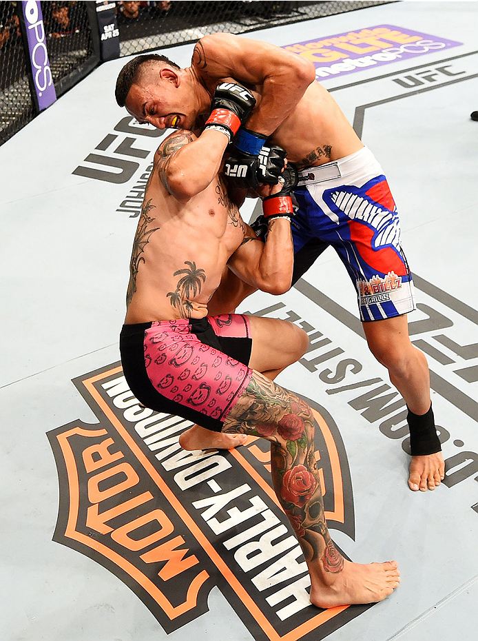 NEWARK, NJ - APRIL 18:  Cub Swanson and Max Holloway grapple in their featherweight bout during the UFC Fight Night event at Prudential Center on April 18, 2015 in Newark, New Jersey.  (Photo by Josh Hedges/Zuffa LLC/Zuffa LLC via Getty Images)