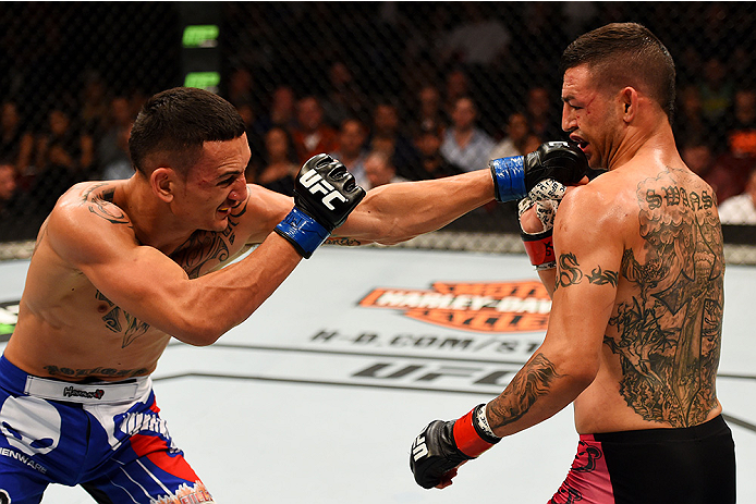 NEWARK, NJ - APRIL 18:  Max Holloway punches Cub Swanson in their featherweight bout during the UFC Fight Night event at Prudential Center on April 18, 2015 in Newark, New Jersey.  (Photo by Josh Hedges/Zuffa LLC/Zuffa LLC via Getty Images)
