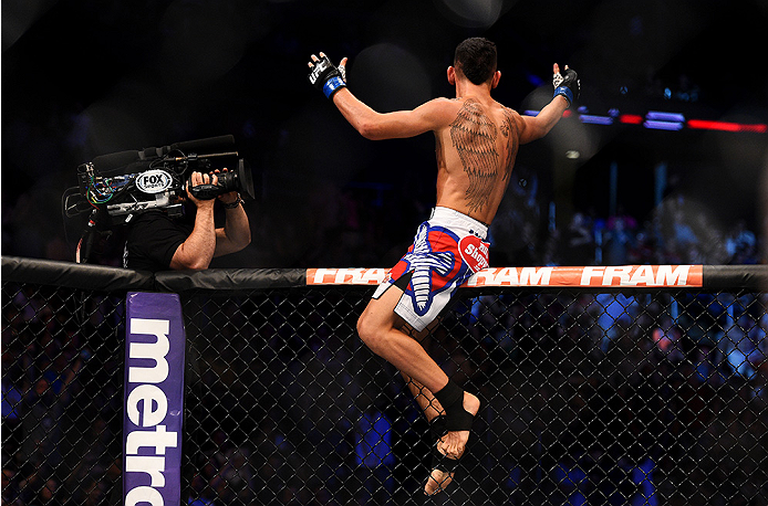 NEWARK, NJ - APRIL 18:  Max Holloway celebrates his win over Cub Swanson in their featherweight bout during the UFC Fight Night event at Prudential Center on April 18, 2015 in Newark, New Jersey.  (Photo by Jeff Bottari/Zuffa LLC/Zuffa LLC via Getty Images)