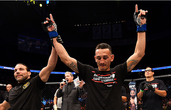 NEWARK, NJ - APRIL 18:  Max Holloway celebrates his win over Cub Swanson in their featherweight bout during the UFC Fight Night event at Prudential Center on April 18, 2015 in Newark, New Jersey.  (Photo by Josh Hedges/Zuffa LLC/Zuffa LLC via Getty Images)
