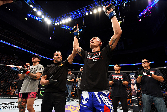 NEWARK, NJ - APRIL 18:  Max Holloway celebrates his win over Cub Swanson (L) in their featherweight bout during the UFC Fight Night event at Prudential Center on April 18, 2015 in Newark, New Jersey.  (Photo by Josh Hedges/Zuffa LLC/Zuffa LLC via Getty Images)