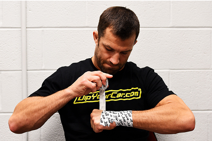 NEWARK, NJ - APRIL 18:  Luke Rockhold wraps his own hands prior to his middleweight bout against Lyoto Machida of Brazil during the UFC Fight Night event at Prudential Center on April 18, 2015 in Newark, New Jersey.  (Photo by Jeff Bottari/Zuffa LLC/Zuffa LLC via Getty Images)