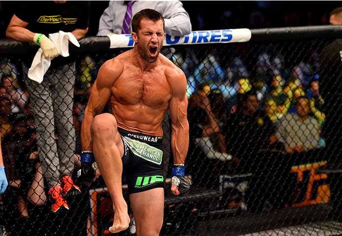 NEWARK, NJ - APRIL 18:  Luke Rockhold celebrates defeating Lyoto Machida of Brazil by tap out in their middleweight bout during the UFC Fight Night event at Prudential Center on April 18, 2015 in Newark, New Jersey.  (Photo by Josh Hedges/Zuffa LLC/Zuffa LLC via Getty Images)