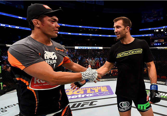NEWARK, NJ - APRIL 18:  Luke Rockhold is congratulated by Lyoto Machida of Brazil after winning by tap out in their middleweight bout during the UFC Fight Night event at Prudential Center on April 18, 2015 in Newark, New Jersey.  (Photo by Josh Hedges/Zuffa LLC/Zuffa LLC via Getty Images)