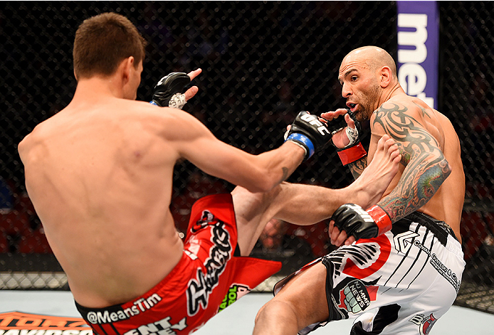 NEWARK, NJ - APRIL 18:  Takeya Mizugaki kicks George Sullivan (R) in their welterweight bout during the UFC Fight Night event at Prudential Center on April 18, 2015 in Newark, New Jersey.  (Photo by Josh Hedges/Zuffa LLC/Zuffa LLC via Getty Images)
