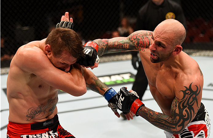 NEWARK, NJ - APRIL 18:  George Sullivan punches Tim Means in their welterweight bout during the UFC Fight Night event at Prudential Center on April 18, 2015 in Newark, New Jersey.  (Photo by Josh Hedges/Zuffa LLC/Zuffa LLC via Getty Images)