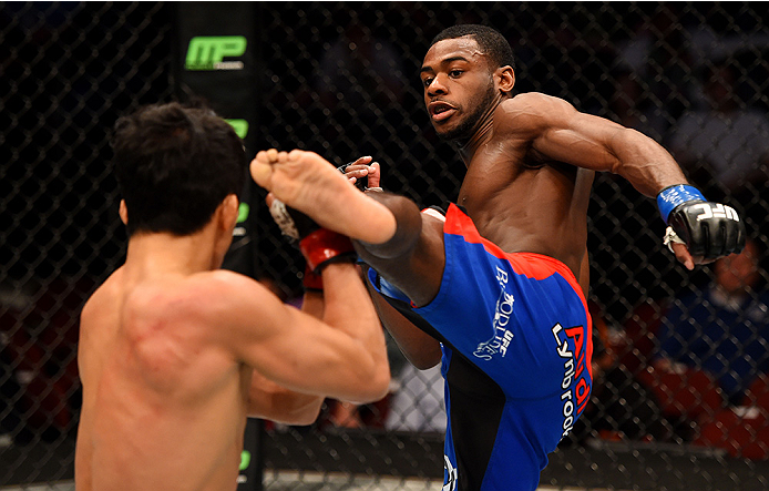NEWARK, NJ - APRIL 18:  Aljamain Sterling (R) kicks Takeya Mizugaki of Japan in their bantamweight bout during the UFC Fight Night event at Prudential Center on April 18, 2015 in Newark, New Jersey.  (Photo by Josh Hedges/Zuffa LLC/Zuffa LLC via Getty Images)