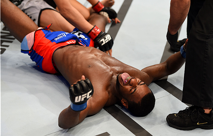 NEWARK, NJ - APRIL 18:  Aljamain Sterling puts Takeya Mizugaki of Japan in a triangle hold to win by tap out in their bantamweight bout during the UFC Fight Night event at Prudential Center on April 18, 2015 in Newark, New Jersey.  (Photo by Josh Hedges/Zuffa LLC/Zuffa LLC via Getty Images)