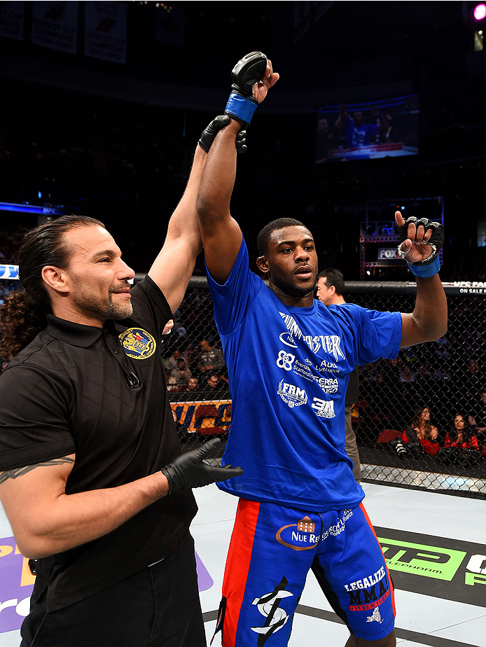 NEWARK, NJ - APRIL 18:  Aljamain Sterling celebrates defeating Takeya Mizugaki of Japan by tap out in their bantamweight bout during the UFC Fight Night event at Prudential Center on April 18, 2015 in Newark, New Jersey.  (Photo by Josh Hedges/Zuffa LLC/Zuffa LLC via Getty Images)