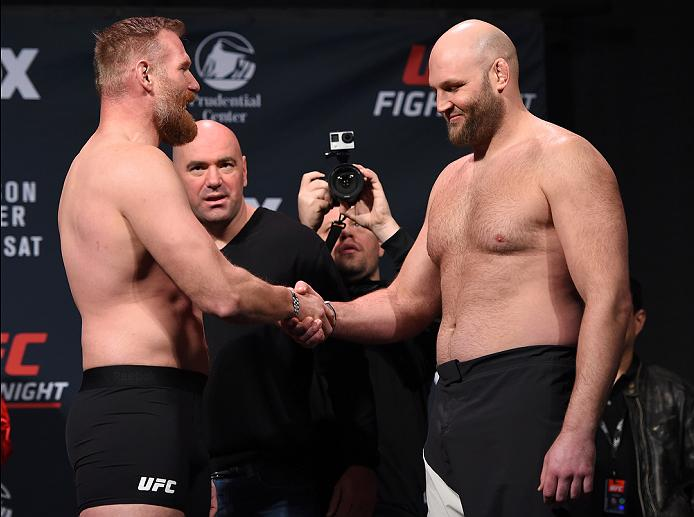 NEWARK, NJ - JANUARY 29:  (L-R) Opponents Josh Barnett and Ben Rothwell face off during the UFC Fight Night weigh-in at the Prudential Center on January 29, 2016 in Newark, New Jersey. (Photo by Josh Hedges/Zuffa LLC/Zuffa LLC via Getty Images)