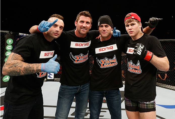 SYDNEY, AUSTRALIA - NOVEMBER 08:  Jake Matthews (R) of Australia poses for a photo with his team after his victory over Vagner Rocha in their lightweight bout during the UFC Fight Night event inside Allphones Arena on November 8, 2014 in Sydney, Australia.  (Photo by Josh Hedges/Zuffa LLC/Zuffa LLC via Getty Images)