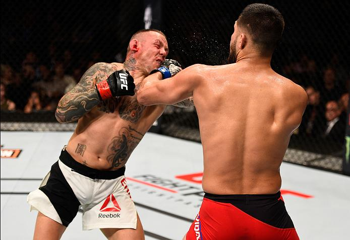 ATLANTA, GA - JULY 30:  (R-L) Jorge Masvidal punches Ross Pearson in their welterweight bout during the UFC 201 event on July 30, 2016 at Philips Arena in Atlanta, Georgia. (Photo by Jeff Bottari/Zuffa LLC/Zuffa LLC via Getty Images)