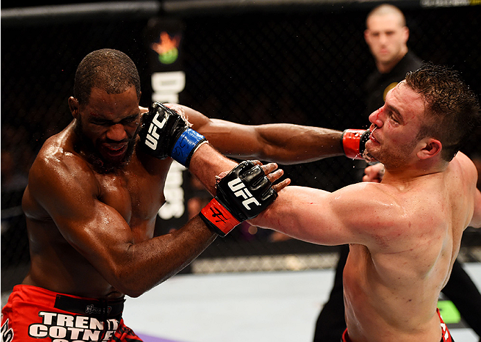 NEWARK, NJ - APRIL 18:  Corey Anderson and Gian Villante exchange blows in their light heavyweight bout during the UFC Fight Night event at Prudential Center on April 18, 2015 in Newark, New Jersey.  (Photo by Josh Hedges/Zuffa LLC/Zuffa LLC via Getty Images)