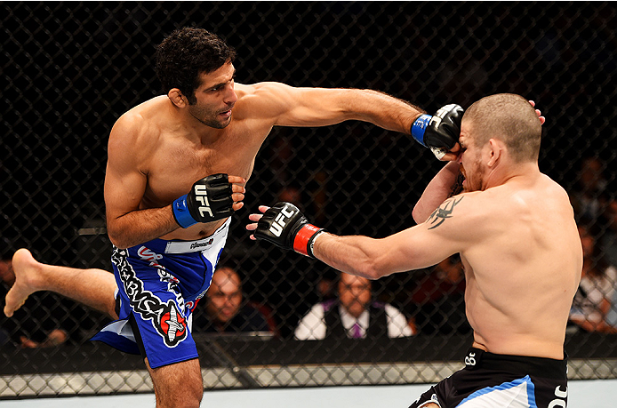 NEWARK, NJ - APRIL 18:  Beneil Dariush (L) of Iran punches Jim Miller in their lightweight bout during the UFC Fight Night event at Prudential Center on April 18, 2015 in Newark, New Jersey.  (Photo by Josh Hedges/Zuffa LLC/Zuffa LLC via Getty Images)