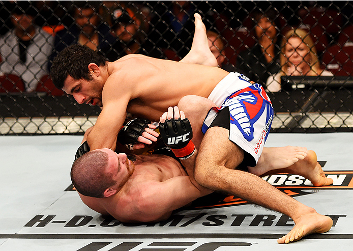 NEWARK, NJ - APRIL 18:  Beneil Dariush of Iran and Jim Miller grapple in their lightweight bout during the UFC Fight Night event at Prudential Center on April 18, 2015 in Newark, New Jersey.  (Photo by Josh Hedges/Zuffa LLC/Zuffa LLC via Getty Images)