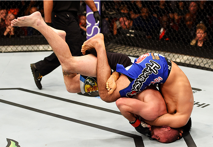 NEWARK, NJ - APRIL 18:  Beneil Dariush of Iran takes down Jim Miller in their lightweight bout during the UFC Fight Night event at Prudential Center on April 18, 2015 in Newark, New Jersey.  (Photo by Josh Hedges/Zuffa LLC/Zuffa LLC via Getty Images)