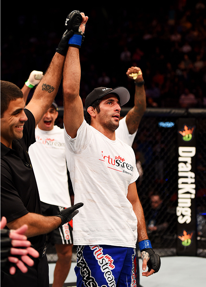 NEWARK, NJ - APRIL 18:  Beneil Dariush of Iran celebrates his win over Jim Miller by unanimous decision in their lightweight bout during the UFC Fight Night event at Prudential Center on April 18, 2015 in Newark, New Jersey.  (Photo by Josh Hedges/Zuffa LLC/Zuffa LLC via Getty Images)
