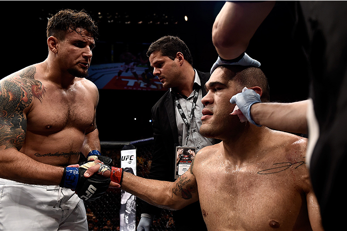 Frank Mir of the United States greets Antonio 'Bigfoot' Silva of Brazil after won their heavyweight bout during the UFC Fight Night at Gigantinho Gymnasium on February 22, 2015 in Porto Alegre, Brazil. (Photo by Buda Mendes/Zuffa LLC)
