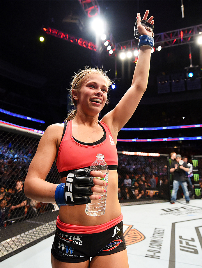 NEWARK, NJ - APRIL 18:  Paige VanZant celebrates defeating Felice Herrig in their women's strawweight bout during the UFC Fight Night event at Prudential Center on April 18, 2015 in Newark, New Jersey.  (Photo by Josh Hedges/Zuffa LLC/Zuffa LLC via Getty Images)