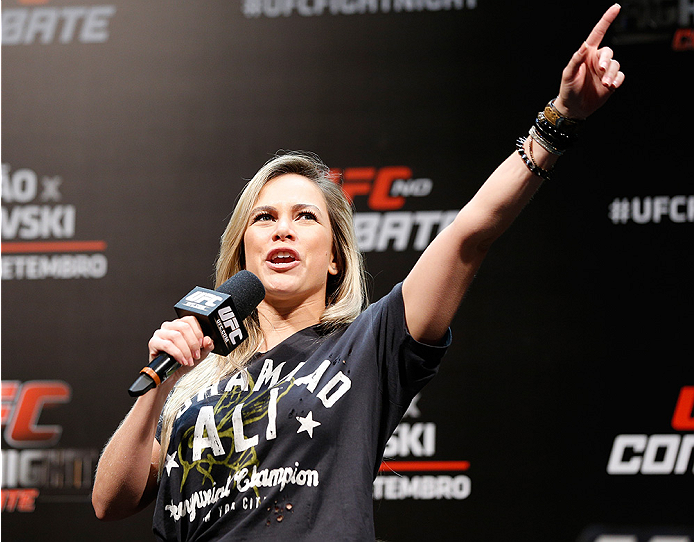 BRASILIA, BRAZIL - SEPTEMBER 12:  UFC host Paula Sack interacts with fans during a Q&A session before the UFC Fight Night weigh-in at the Nilson Nelson Gymnasium on September 12, 2014 in Brasilia, Brazil. (Photo by Josh Hedges/Zuffa LLC/Zuffa LLC via Getty Images)