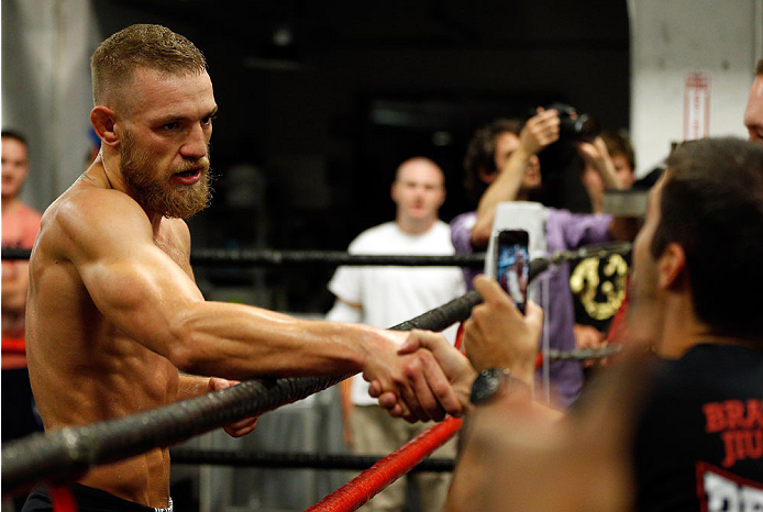 BOSTON, MA - AUGUST 13:  Irish featherweight Conor McGregor interacts with fans during an open training session for media at Peter Welch's Boxing Gym on August 13, 2013 in Boston, Massachusetts. (Photo by Josh Hedges/Zuffa LLC/Zuffa LLC via Getty Images)