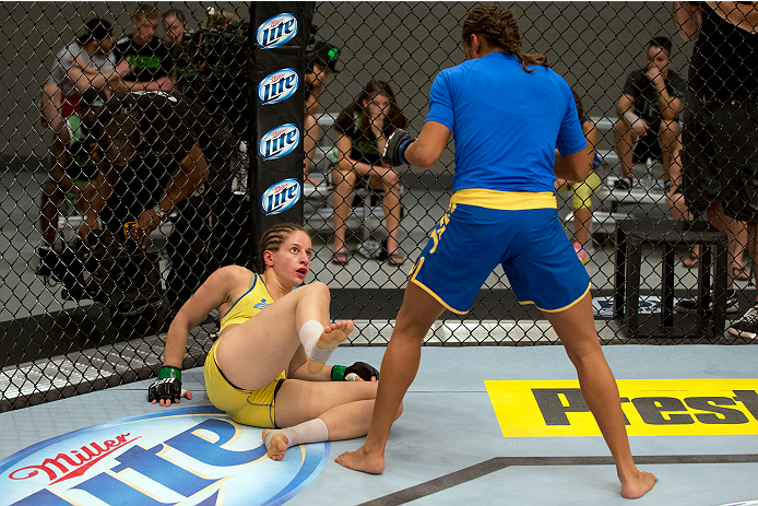 LAS VEGAS, NV - JULY 02:  (R-L) Julianna Pena knocks down Sarah Moras in their semifinal fight during filming of season eighteen of The Ultimate Fighter on July 2, 2013 in Las Vegas, Nevada. (Photo by Josh Hedges/Zuffa LLC/Zuffa LLC via Getty Images) *** Local Caption *** Julianna Pena; Sarah Moras