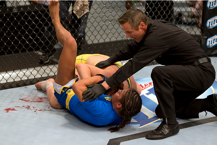 LAS VEGAS, NV - JULY 02:  (L-R) Julianna Pena submits Sarah Moras in their semifinal fight during filming of season eighteen of The Ultimate Fighter on July 2, 2013 in Las Vegas, Nevada. (Photo by Josh Hedges/Zuffa LLC/Zuffa LLC via Getty Images) *** Local Caption *** Julianna Pena; Sarah Moras