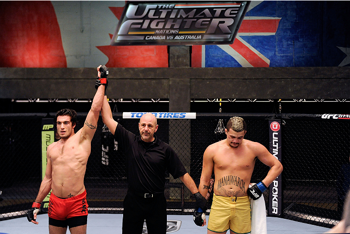 LACHUTE, CANADA - DECEMBER 6:  (L-R) Team Canada fighter Elias Theodorou celebrates after defeating Team Australia fighter Tyler Manawaroa in their semifinal middleweight fight during filming of The Ultimate Fighter Nations television series on December 6, 2013 in Lachute, Quebec, Canada. (Photo by Richard Wolowicz/Zuffa LLC/Zuffa LLC via Getty Images) *** Local Caption *** Elias Theodorou; Tyler Manawaroa