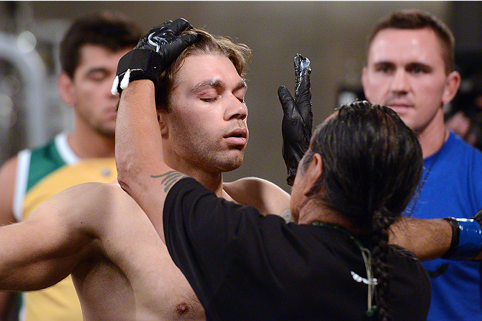 LACHUTE, CANADA - NOVEMBER 8:  Team Australia fighter Chris Indich prepares to enter the Octagon prior to facing Team Canada fighter Chad Leprise in their welterweight bout during filming of The Ultimate Fighter Nations television series on November 8, 2013 in Lachute, Quebec, Canada. (Photo by Richard Wolowicz/Zuffa LLC/Zuffa LLC via Getty Images) *** Local Caption *** Chris Indich