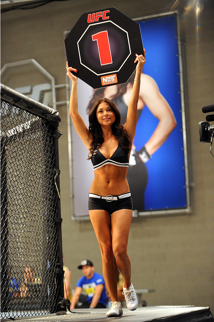 LAS VEGAS, NV - JUNE 10:  UFC Octagon Girl Arianny Celeste introduces a round during the Chris Holdsworth v Chris Beal preliminary fight during filming of season eighteen of The Ultimate Fighter on June 10, 2013 in Las Vegas, Nevada. (Photo by Al Powers/Zuffa LLC/Zuffa LLC via Getty Images) *** Local Caption ***Arianny Celste