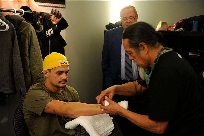 LACHUTE, CANADA - NOVEMBER 11:  Team Australia fighter Tyler Manawaroa gets his hands taped prior to facing Team Canada fighter Nordine Taleb in their middleweight fight during filming of The Ultimate Fighter Nations television series on November 11, 2013 in Lachute, Quebec, Canada. (Photo by Richard Wolowicz/Zuffa LLC/Zuffa LLC via Getty Images) *** Local Caption ***Tyler Manawaroa
