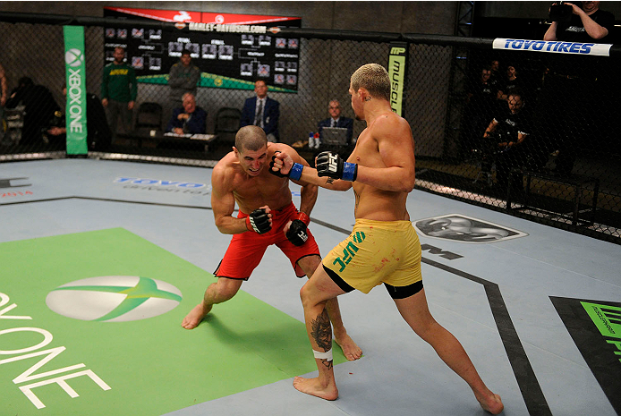 LACHUTE, CANADA - NOVEMBER 11:  (R-L) Team Australia fighter Tyler Manawaroa punches Team Canada fighter Nordine Taleb in their middleweight fight during filming of The Ultimate Fighter Nations television series on November 11, 2013 in Lachute, Quebec, Canada. (Photo by Richard Wolowicz/Zuffa LLC/Zuffa LLC via Getty Images) *** Local Caption *** Nordine Taleb; Tyler Manawaroa