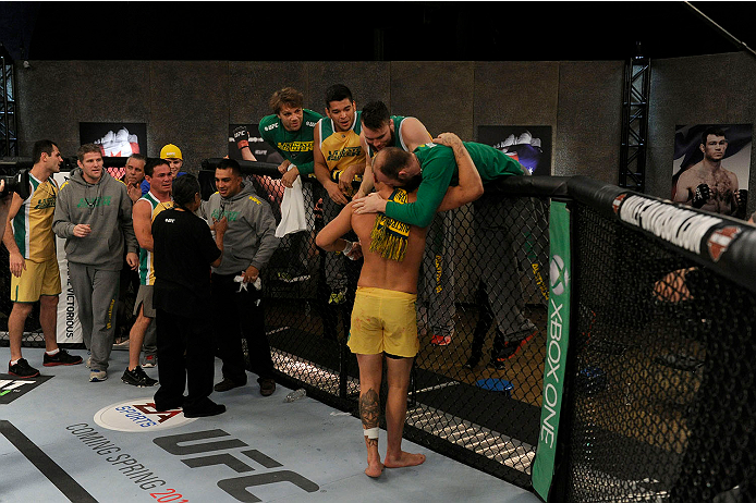 LACHUTE, CANADA - NOVEMBER 11:  Team Australia fighter Tyler Manawaroa celebrates with his team after defeating Team Canada fighter Nordine Taleb in their middleweight fight during filming of The Ultimate Fighter Nations television series on November 11, 2013 in Lachute, Quebec, Canada. (Photo by Richard Wolowicz/Zuffa LLC/Zuffa LLC via Getty Images) *** Local Caption *** Tyler Manawaroa