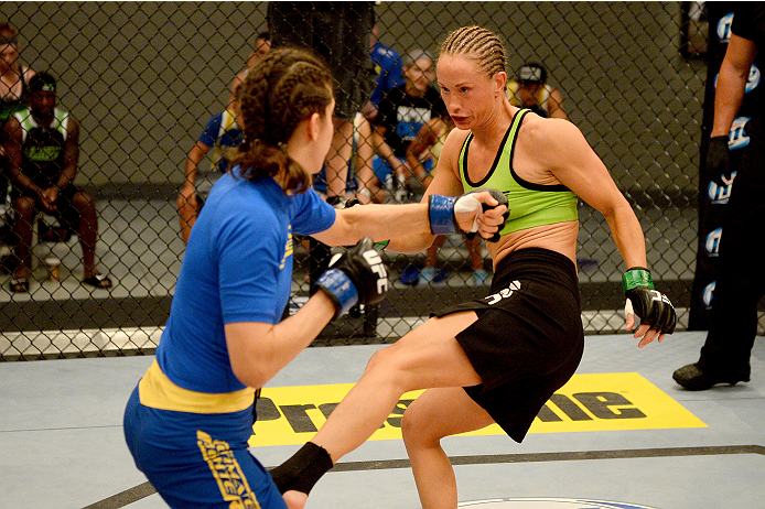 LAS VEGAS, NV - JUNE 12:  (R-L) Jessica Rakoczy kicks Roxanne Modafferi in their preliminary fight during filming of season eighteen of The Ultimate Fighter on June 12, 2013 in Las Vegas, Nevada. (Photo by Al Powers/Zuffa LLC/Zuffa LLC via Getty Images) *** Local Caption *** Jessica Rakoczy; Roxanne Modafferi