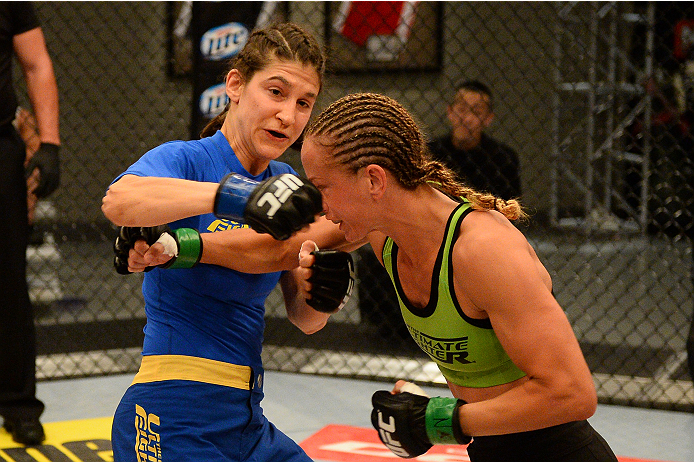 LAS VEGAS, NV - JUNE 12:  (L-R) Roxanne Modafferi punches Jessica Rakoczy in their preliminary fight during filming of season eighteen of The Ultimate Fighter on June 12, 2013 in Las Vegas, Nevada. (Photo by Al Powers/Zuffa LLC/Zuffa LLC via Getty Images) *** Local Caption *** Jessica Rakoczy; Roxanne Modafferi