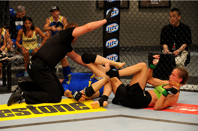 LAS VEGAS, NV - JUNE 12:  (L-R) Jessica Rakoczy is  pulled off Roxanne Modafferi in their preliminary fight during filming of season eighteen of The Ultimate Fighter on June 12, 2013 in Las Vegas, Nevada. (Photo by Al Powers/Zuffa LLC/Zuffa LLC via Getty Images) *** Local Caption *** Jessica Rakoczy; Roxanne Modafferi