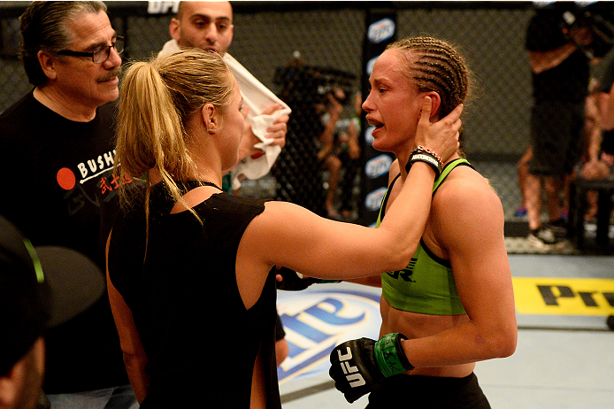 LAS VEGAS, NV - JUNE 12:  (L-R) Coach Ronda Rousey congratulates Jessica Rakoczy in her corner after defeating Roxanne Modafferi (not pictured) in their preliminary fight during filming of season eighteen of The Ultimate Fighter on June 12, 2013 in Las Vegas, Nevada. (Photo by Al Powers/Zuffa LLC/Zuffa LLC via Getty Images) *** Local Caption *** Ronda Rousey; Jessica Rakoczy