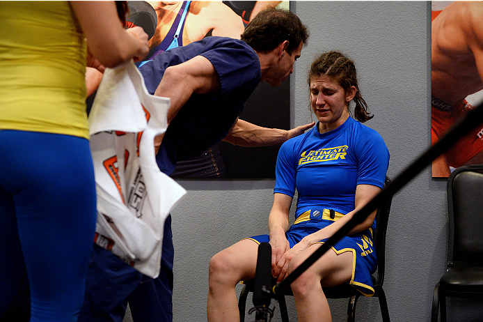 LAS VEGAS, NV - JUNE 12:  Roxanne Modafferi receives medical attention after being defeated by Jessica Rakoczy (not pictured) in their preliminary fight during filming of season eighteen of The Ultimate Fighter on June 12, 2013 in Las Vegas, Nevada. (Photo by Al Powers/Zuffa LLC/Zuffa LLC via Getty Images) *** Local Caption *** Roxanne Modafferi