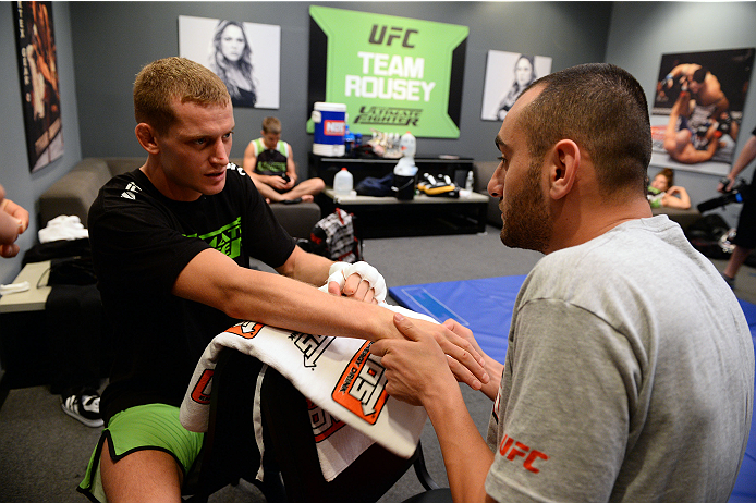 LAS VEGAS, NV - JUNE 14:  David Grant (L) gets his hands wrapped by trainer Team Rousey trainer Edmond Tarverdyan (R) before his preliminary fight against Louis Fisette (not pictured) during filming of season eighteen of The Ultimate Fighter on June 14, 2013 in Las Vegas, Nevada. (Photo by Al Powers/Zuffa LLC/Zuffa LLC via Getty Images) *** Local Caption ***David Grant; Edmond Tarverdyan