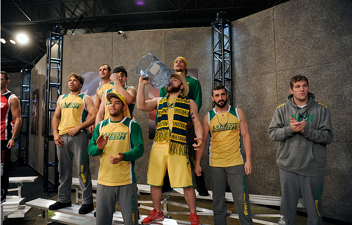 LACHUTE, CANADA - NOVEMBER 14:  Team Australia cheers on Richard Walsh before he faces Team Canada fighter Matthew Desroches in their welterweight fight during filming of The Ultimate Fighter Nations television series on November 14, 2013 in Lachute, Quebec, Canada. (Photo by Richard Wolowicz/Zuffa LLC/Zuffa LLC via Getty Images) *** Local Caption *** Richard Walsh; Matthew Desroches