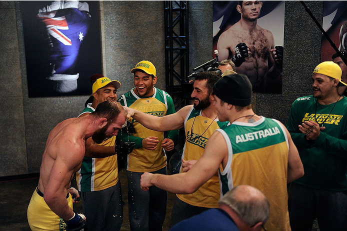LACHUTE, CANADA - NOVEMBER 14:  Team Australia fighter Richard Walsh is congratulated by his teammates after defeating Team Canada fighter Matthew Desroches in their welterweight fight during filming of The Ultimate Fighter Nations television series on November 14, 2013 in Lachute, Quebec, Canada. (Photo by Richard Wolowicz/Zuffa LLC/Zuffa LLC via Getty Images) *** Local Caption *** Richard Walsh