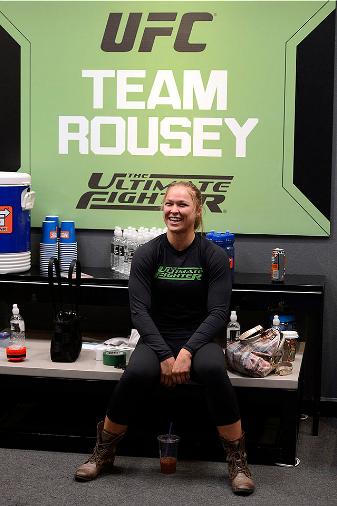 LAS VEGAS, NV - JUNE 17:  Coach Ronda Rousey sits in the locker room prior to the matchup between Raquel Pennington and Jessamyn Duke (not pictured) in their preliminary fight during filming of season eighteen of The Ultimate Fighter on June 17, 2013 in Las Vegas, Nevada. (Photo by Jeff Bottari/Zuffa LLC/Zuffa LLC via Getty Images) *** Local Caption *** Ronda Rousey