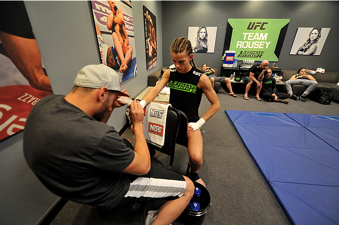 LAS VEGAS, NV - JUNE 17:  Team Rousey trainer Edmond Tarverdyan (L) wraps the hands of Jessamyn Duke (R) before her preliminary fight against Raquel Pennington (not pictured) during filming of season eighteen of The Ultimate Fighter on June 17, 2013 in Las Vegas, Nevada. (Photo by Jeff Bottari/Zuffa LLC/Zuffa LLC via Getty Images) *** Local Caption *** Edmond Tarverdyan; Jessamyn Duke