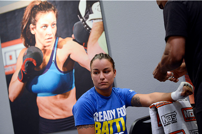 LAS VEGAS, NV - JUNE 17:  Raquel Pennington gets her hands wrapped before her matchup against Jessamyn Duke (not pictured) in their preliminary fight during filming of season eighteen of The Ultimate Fighter on June 17, 2013 in Las Vegas, Nevada. (Photo by Jeff Bottari/Zuffa LLC/Zuffa LLC via Getty Images) *** Local Caption *** Raquel Pennington
