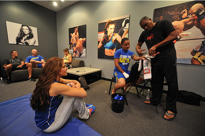LAS VEGAS, NV - JUNE 17:  (L-R) Coach Miesha Tate speaks with Raquel Pennington as she gets her hands wrapped before her matchup against Jessamyn Duke (not pictured) in their preliminary fight during filming of season eighteen of The Ultimate Fighter on June 17, 2013 in Las Vegas, Nevada. (Photo by Jeff Bottari/Zuffa LLC/Zuffa LLC via Getty Images) *** Local Caption *** Raquel Pennington; Miesha Tate