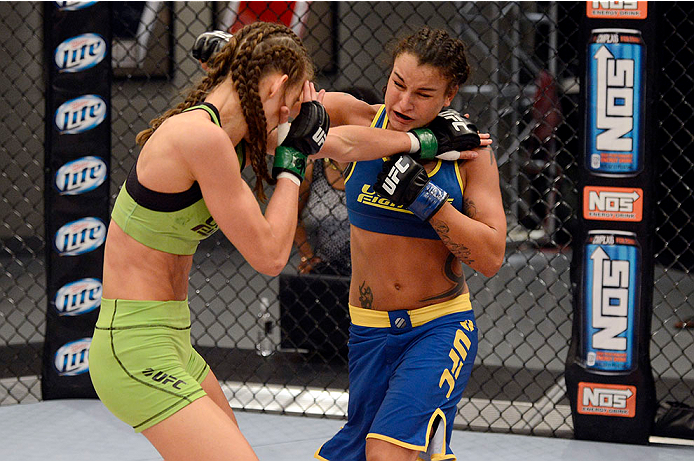 LAS VEGAS, NV - JUNE 17:  (R-L) Raquel Pennington punches Jessamyn Duke in their preliminary fight during filming of season eighteen of The Ultimate Fighter on June 17, 2013 in Las Vegas, Nevada. (Photo by Jeff Bottari/Zuffa LLC/Zuffa LLC via Getty Images) *** Local Caption *** Raquel Pennington; Jessamyn Duke